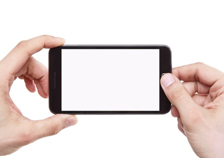 hand holding phone: Taking photo with smart phone isolated on white background