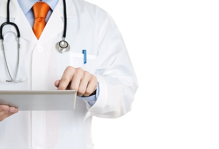 man doctor: Doctor working on a digital tablet with copy space