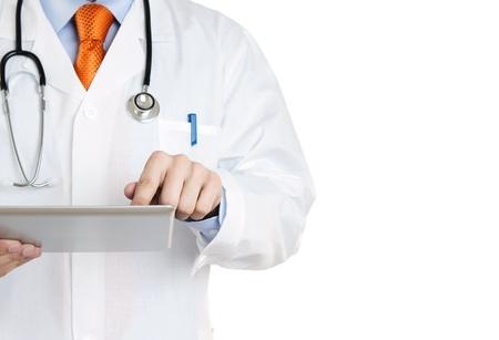 dottore stetoscopio: Medico che lavorava su una tavoletta digitale con copia spazio