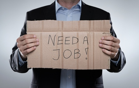economic depression: Young fired businessman looking for a job