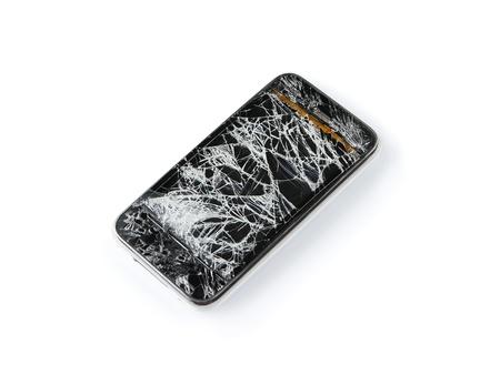 Broken damaged smart phone isolated on white background photo