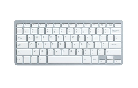 keyboard key: Modern aluminum computer keyboard isolated on white background