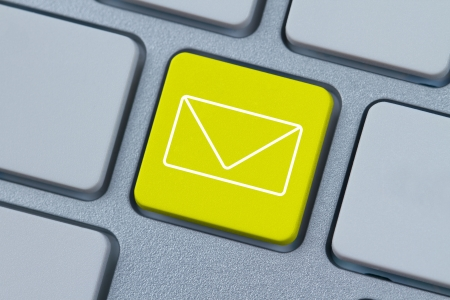 spam mail: Mail icon at computer key Stock Photo