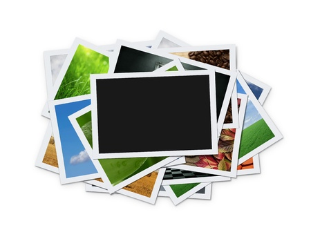 Stack of instant photographs isolated on white background photo