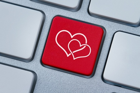 Online love, two hearts symbol at the computer key Stock Photo - 13414709