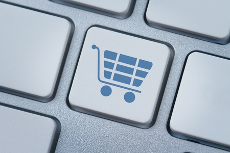 Shopping cart symbol at the computer key photo