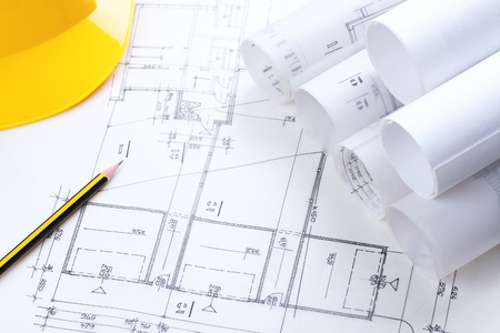 Architectural construction plans with pencil and hardhat on it Stock Photo - 13503544