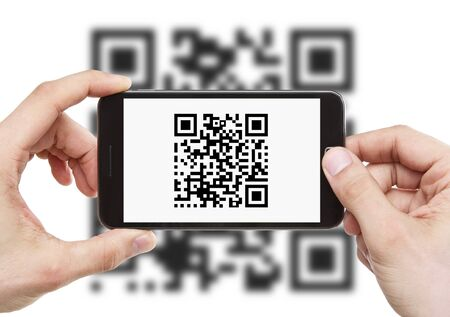 Scanning QR code with mobile smart phone photo