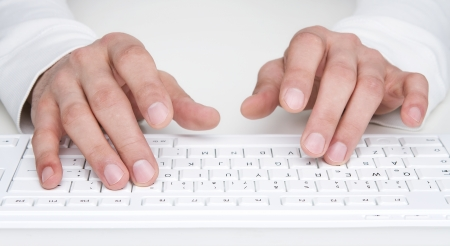 Close up of human hands typing at the keyboard Stock Photo - 13726956