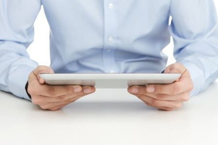 Close up of man reading at digital tablet photo
