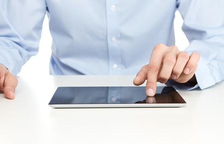 man using computer: Close up of young businessman using digital tablet Stock Photo