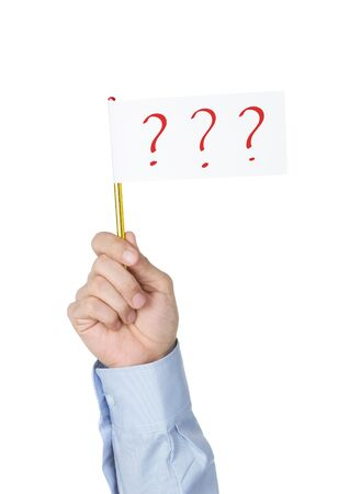 Office worker holding with white paper flag with question marks photo