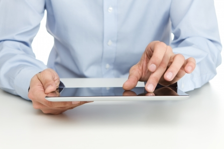 Close up of young businessman using digital tablet photo