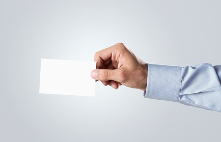 holding a sign: Human hand holding blank business card with copy space