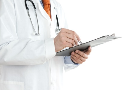 doctor clipboard: Doctor writing notes at the clipboard isolated on white background