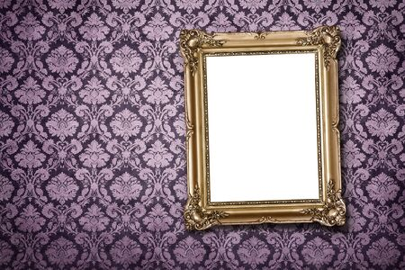 Blank gold picture frame at the ornate wall with clipping path photo