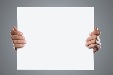 holding blank sign: Hands holding blank advertisement card with copy space Stock Photo