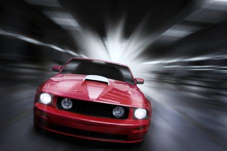 racing car: Luxury red sport car speeding in a underground parking garage