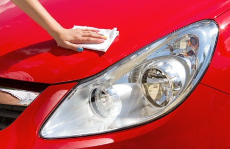 polishing: Close up of young girl cleaning the car Stock Photo
