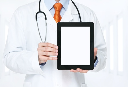 Doctor at the hospital holding blank digital tablet with clipping path for the screen photo