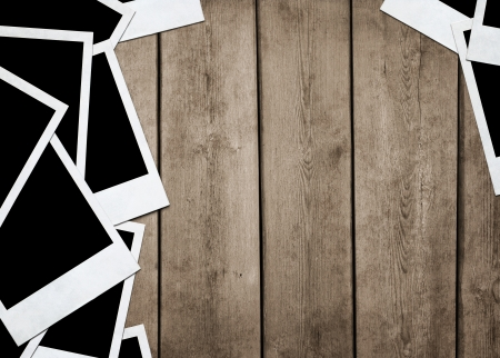 Stack of old instant photos at grunge wooden background with copy space Stock Photo - 14420656