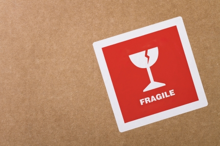 mail order: Fragile sticker at the cardboard box with copy space