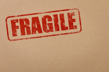Fragile stamp on cardboard box with copy space photo