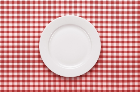 checker: Empty plate at classic checkered tablecloth Stock Photo