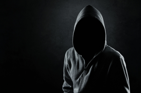 terror: Silhouette of hooded man or hooligan
