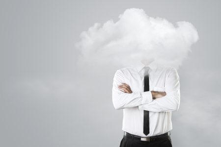 air pollution: Young businessman with head in the clouds Stock Photo