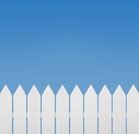 White wooden fence against blue sky with copy space photo