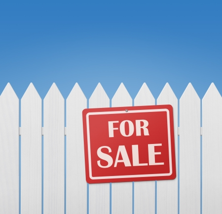 For sale sign on white wooden fence against blue sky with copy space photo