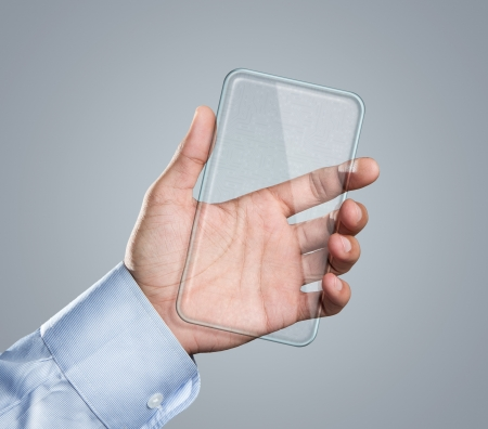 Male hand holding blank futuristic transparent smart phone with copy space photo