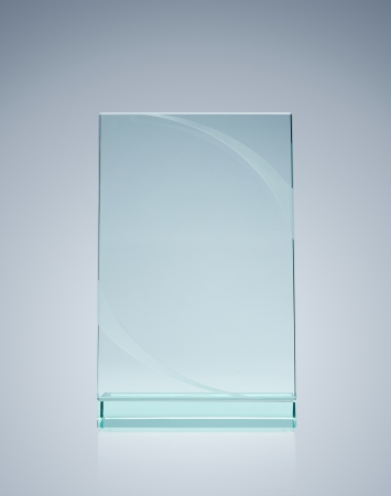 Blank glass award over gray background with copy space photo