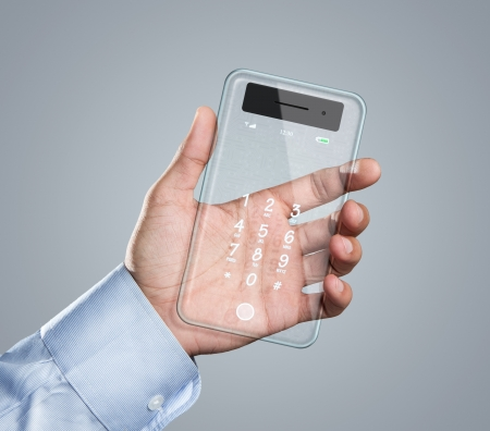 Male hand holding futuristic transparent smart phone with copy space photo