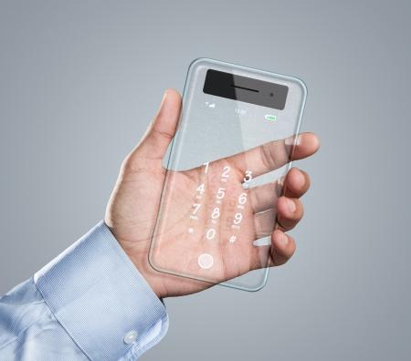 futuristic man: Male hand holding futuristic transparent smart phone with copy space Stock Photo