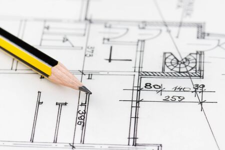 Close up of yellow pencil on architectural drawing Stock Photo - 14915532