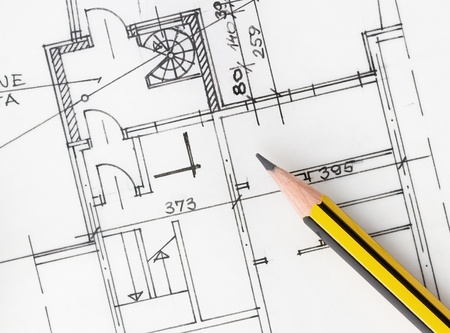 Yellow pencil over architectural plans Stock Photo - 14915534