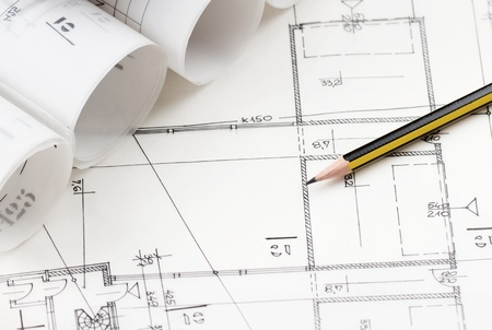 blueprint: Close up of yellow pencil over architectural drawings