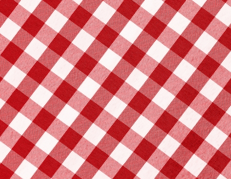 Close up of red checkered tablecloth with copy space