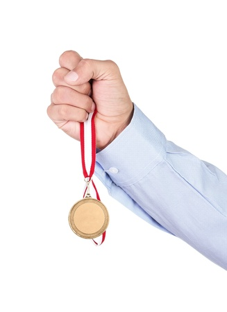 best place: Businessman holding blank gold medal isolated on white background