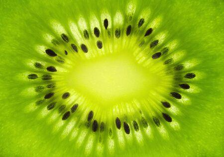 Macro shot of fresh kiwi fruit cross section photo