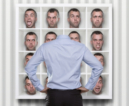 different strategy: Conceptual image of young businessman choosing which face expression to wear