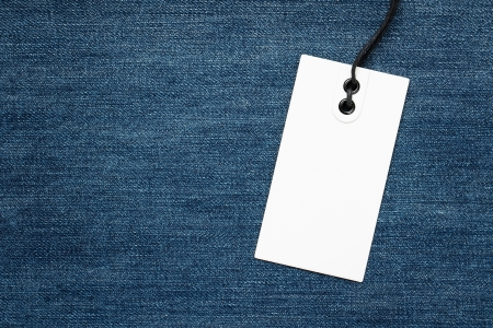 Blank tag over denim background with copy space Stock Photo - 15352293