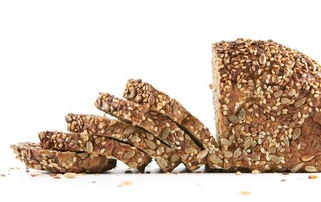 baked bread: Fresh sliced organic homemade bread isolated on white background