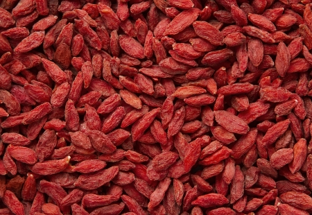 Dried goji berries background photo