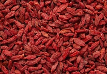 goji berry: Dried goji berries background Stock Photo