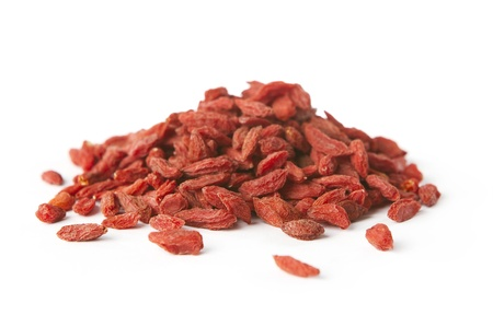 goji berry: Pile of dry goji berries isolated on white background