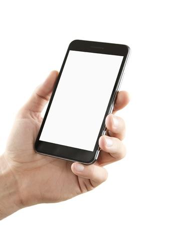 terra arrendada: Mão masculina que prende o telefone esperto em branco isolado no fundo branco