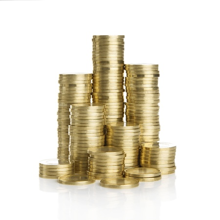 stack of dollars: Stack of golden coins isolated on white background Stock Photo